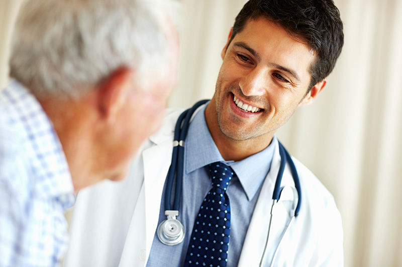 Medical doctor talks to his patient